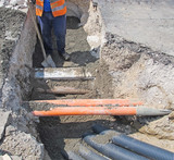 laying of optical fiber and electric cables in a roadworks worke