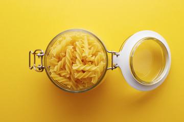 Raw fusilli pasta on a glass jar