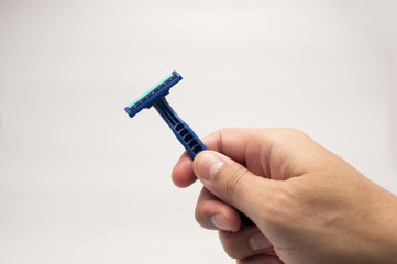hands showing a razor