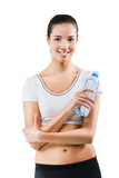 Beautiful fit woman holding a bottle of water