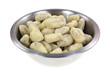 Uncooked potato gnocchi in a stainless steel bowl
