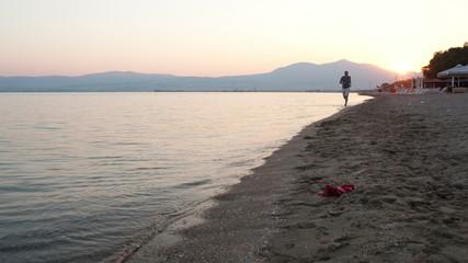 Man running along a tropical beach