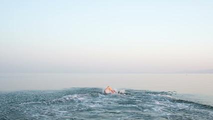 Man rushing into the sea