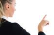 Blonde businesswoman pointing upwards