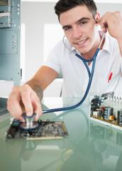 Handsome joyful computer engineer holding stethoscope