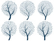 Abstract silhouettes of trees with snowflakes.
