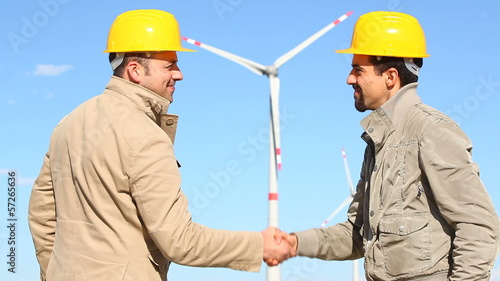 Engineers giving Handshake in Wind Turbine Power Station