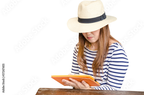 Woman sitting on public bench with tablet