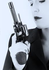 Dangerous woman in black with big handgun