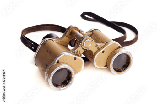 Old German military binoculars on a white background