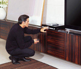 man using dvd player