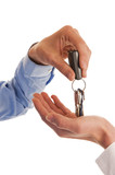 Two hands handing over keys
