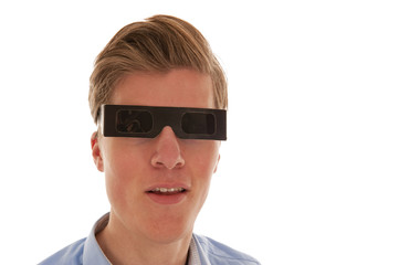 Guy looking through eclipse glasses