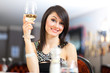 Beautiful woman holding a glass of wine