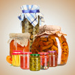 Set of canned vegetables and fruits on beige background