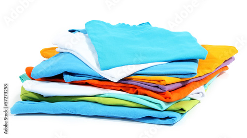 Neatly folded shirts isolated on white