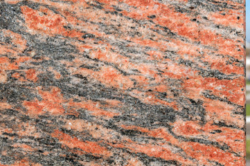 Processed red marble with black streaks