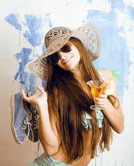 cute bright woman in sunglasses and hat with cocktail in bikini