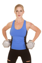 fitness woman blue tank big weights by hips