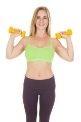 fitness woman green bra weights both by shoulders
