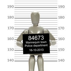 Grey mannequin posing in mugshot