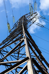 High voltage electricity pylon against blue sky