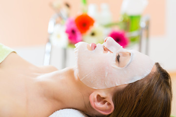 Wellness - woman getting face mask in spa