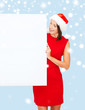 woman in santa helper hat with blank white board