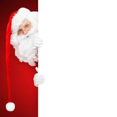 Santa Claus hinter weisser Wand