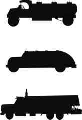 vintage oil delivery trucks in silhouette