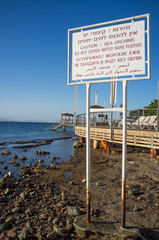 Sea urchines treading warning sign