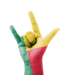 Hand making I love you sign, Benin flag painted