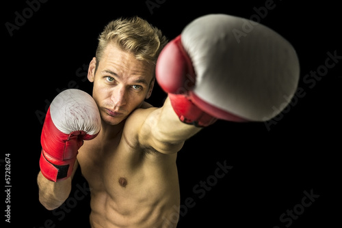 Young boxer performing a punch