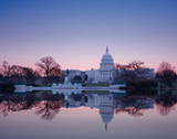 Fototapety Sunrise behind the dome of the Capitol in DC