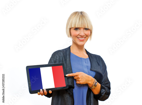 attractive blond woman holding tablet with france flag