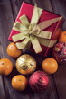 Christmas gift, xmas baubles and mandarins, vertical shot