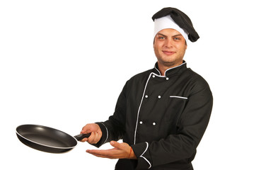 Chef man with empty frying pan