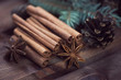 Cinnamon sticks, star anise, fir-tree branches and cones
