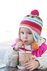 Cute little girl drinks