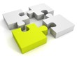 white jigsaw puzzles group with one green individual piece