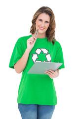 Smiling environmental activist holding clipboard looking at came