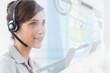 Pleased call center employee using futuristic street map interfa