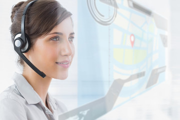 Pleased call center employee using futuristic street map interfa