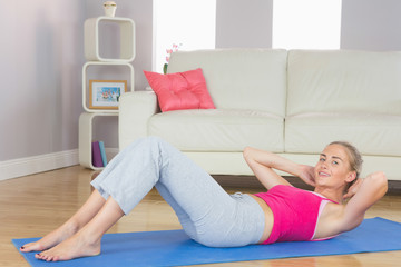 Sporty content blonde doing sit ups