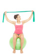 Attractive sporty brunette stretching with resistance band