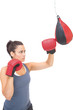 Stern sporty brunette training with punching bag
