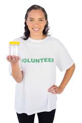 Volunteer woman showing jar