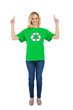 Happy blonde environmental activist pointing up