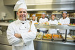 Experienced head chef posing proudly in a modern kitchen