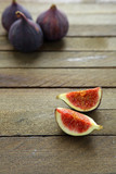 fresh and juicy figs on a wooden table